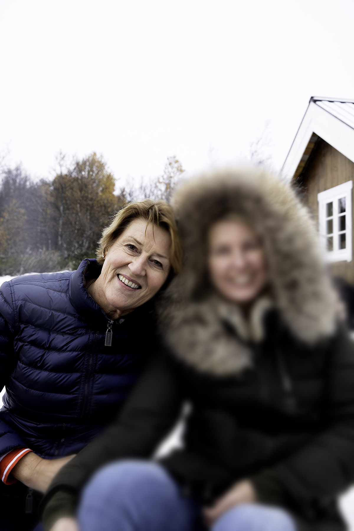 Hildegunn and Jannicke together in front of a cabin
